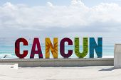 CANCUN - JANUARY 20: CANCUN inscription in front of the Playa Delfines beach on 20 January 2015 in Cancun, Mexico. This is one of the best beaches in the Mexico.