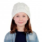 Smiling pretty girl with wool cap isolated on a white background