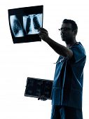 one  man doctor surgeon radiologist medical examining lung torso x-ray image silhouette isolated on white background