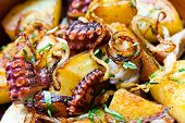 stock photo of octopus  - Pulpo a feira octopus galician style. octopus with fried potatoes.