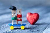 Clothespins couple. Skateboarding.
