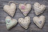 Vintage hearts on a wooden background