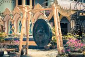 stock photo of vibration plate  - Large gong in the temple and in the background the typical architecture Thailand Asia - JPG