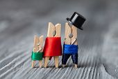 Playground Family. Abstract: The Family Of Linen Clothespins. Man, Woman With Children. Vintage Wood