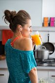 Portrait Of Fitness Young Woman Drinking Pumpkin Smoothie In Kit