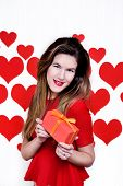White caucasian woman with red lips giving a gift on heart shaped background.Valentine`s day