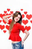 White caucasian woman with red lips standing and playing with hair on heart shaped background.Valent