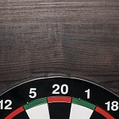 target on brown wooden table background