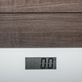 scales on the wooden floor