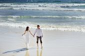 Bride And Groom Holding Hands Near Sea In Wedding Day