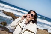 Attractive Woman On Beach Talking On The Phone