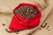 Coffe Beans In Red Velvet Sac