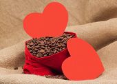 Two Red Paper Hearts With Coffe Beans In Red Velvet Sac