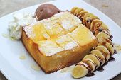 Toast  Topped With Honey And Ice-cream , Banana.