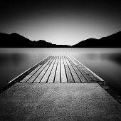 Jetty on a lake in Austria, long time exposure