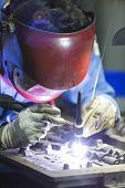 stock photo of tig  - operator repair mold by TIG welding in manufacturing factory - JPG