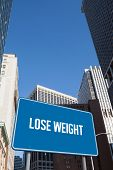 The word lose weight and blue billboard against new york
