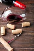 Wine Corks, Corkscrew And Glass With A Red Wine