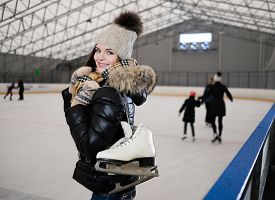 picture of shoulder-blade  - Cheerful girl with skates on ice skating rink  - JPG