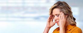 image of hypertensive  - Woman having headache migraine - JPG