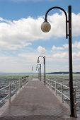 stock photo of pier a lake  - long pier that extends out over the lake - JPG