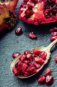 image of pomegranate  - Pieces and grains of ripe pomegranate - JPG