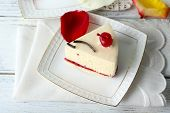 stock photo of cheesecake  - Tasty piece of cheesecake on plate on table close up - JPG
