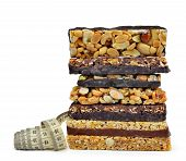 pic of roughage  - Chocolate Muesli Bars with measuring tape isolated on white background - JPG