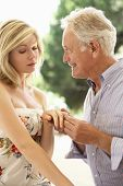 picture of propose  - Older Man Proposing To Younger Woman - JPG