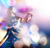 picture of double-bass  - Man playing bass guitar in live concert sequence - JPG
