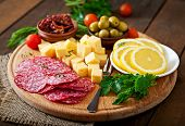 image of antipasto  - Antipasto catering platter with salami and cheese on a wooden background - JPG