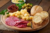 foto of antipasto  - Antipasto catering platter with salami and cheese on a wooden background - JPG