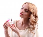 foto of perfume bottles  - Beautiful young woman with perfume bottle isolate on white - JPG