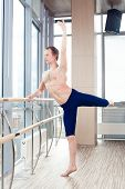 pic of ballet barre  - in the hall man doing stretching near Barre - JPG