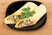 image of shawarma  - Two Shawarma with chicken in black plate on wooden bamboo table - JPG