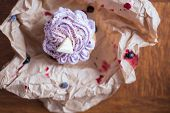 picture of chocolate muffin  - Unpacked blueberry muffin with white chocolate on top - JPG