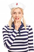 image of outfits  - Vertical shot of a beautiful blond woman in sailor outfit holding finger on her lips and looking at the camera isolated on white background - JPG