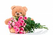 stock photo of bunch roses  - Bunch of roses and a teddy bear on white background - JPG