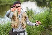 image of catch fish  - Fisherman on the river bank - JPG