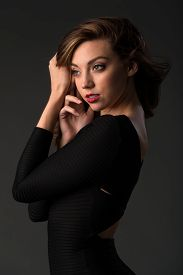 image of tight dress  - Beautiful young brunette in a tight black dress - JPG