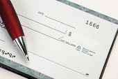 Cheque book with pen for business concept