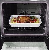 roast chicken and potatoes in the oven