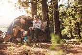 Постер, плакат: Happy Campers Making Coffee In The Wilderness