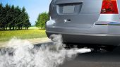 stock photo of car carrier  - pollution of environment by combustible gas of a car - JPG