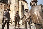 Statues of D'Artagnan and the three musketeers.
