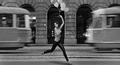 Fine art photo- young woman holding balloons in a empty city street