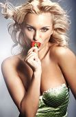 picture of strawberry blonde  - Young lady eating a strawberry - JPG