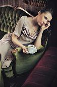 Calm lady drinking coffee
