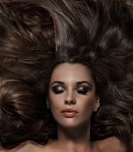 image of brunette hair  - Beauty brunette with long hair - JPG