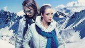 Fashionable couple over alpine mountains